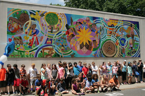 Artist transforms student creations into community murals for Community mural